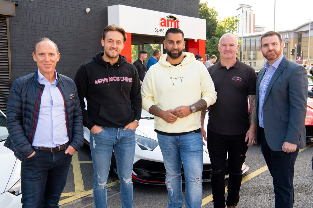 AMT managing director, Bobby Thompson, Yianni, and Ian Harrison, Yorkshire Supercar Club presidnet, AMT retail sales manager outside AMT