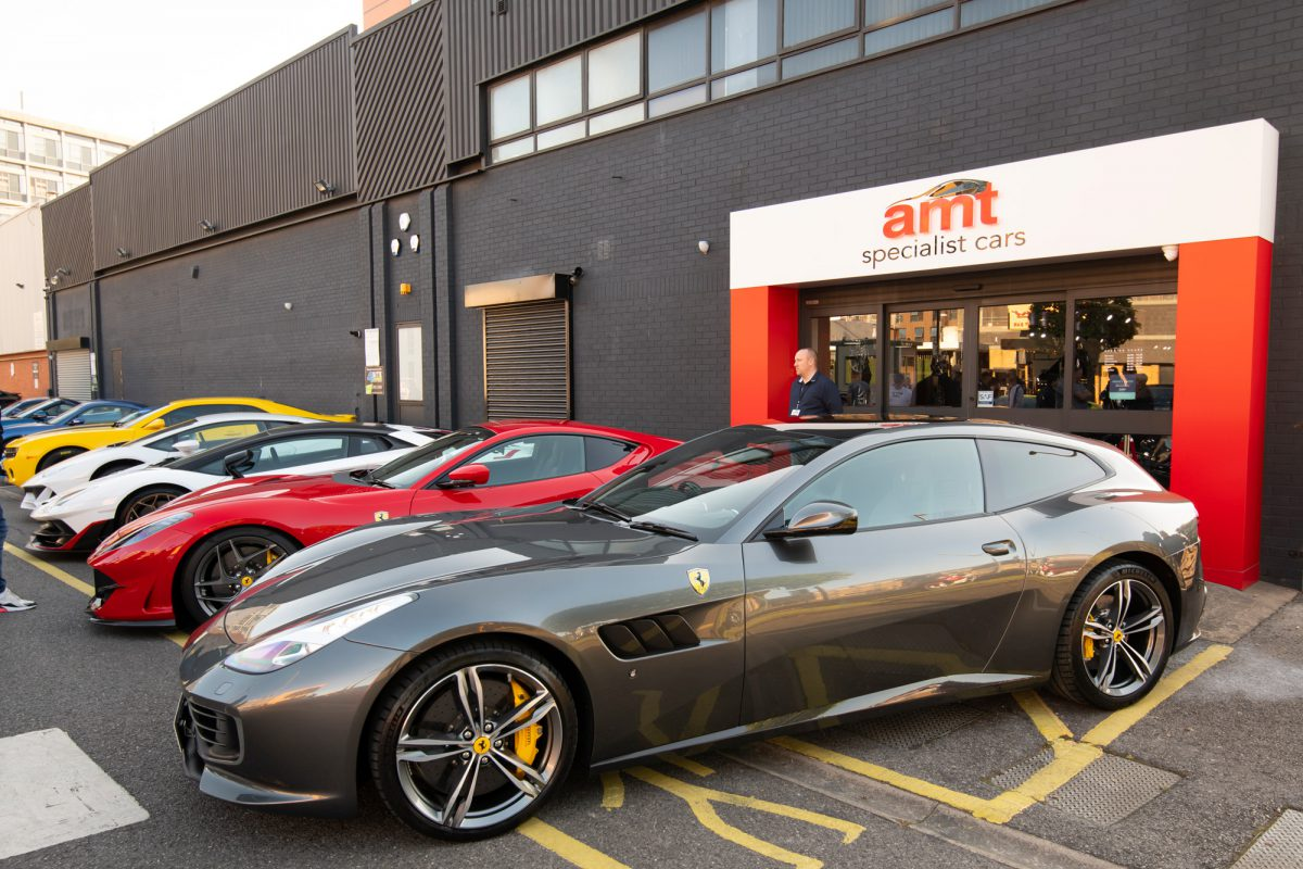 Row of supercars outside AMT