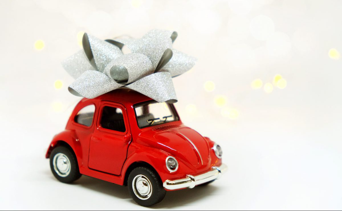 Red toy car with a bow on top